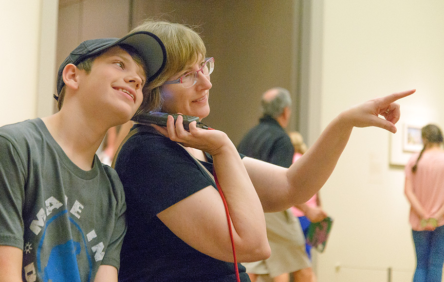 Mom and son listening to audio guide together