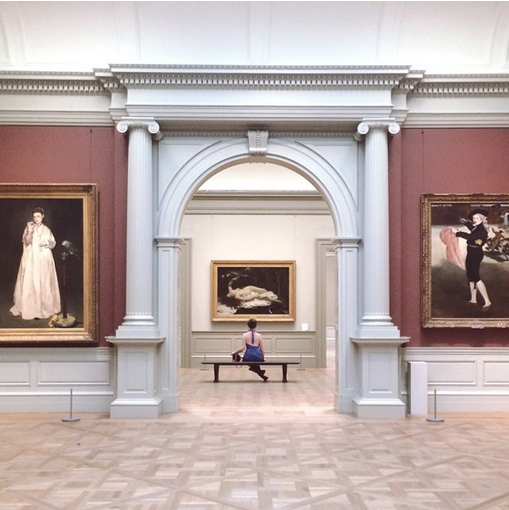 Lone museum visitor sits on bench in an empty Met gallery